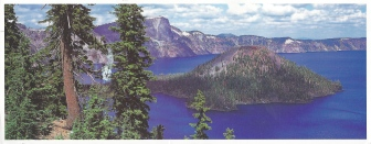 """Crater Lake National Park, Oregon."" Crater Lake is widely known for its intense blue color and spectaucular views. During summer, vistors may navigate teh Rim Drive around teh lake, enjoy boart tours on eh lake surface, stay in the historic Crater Laek Lodge, camp at Mazama Village or hike some of the park's various trails including Mount Scott at 8,929 feet. Photographer, Deitrich Stock Photo."