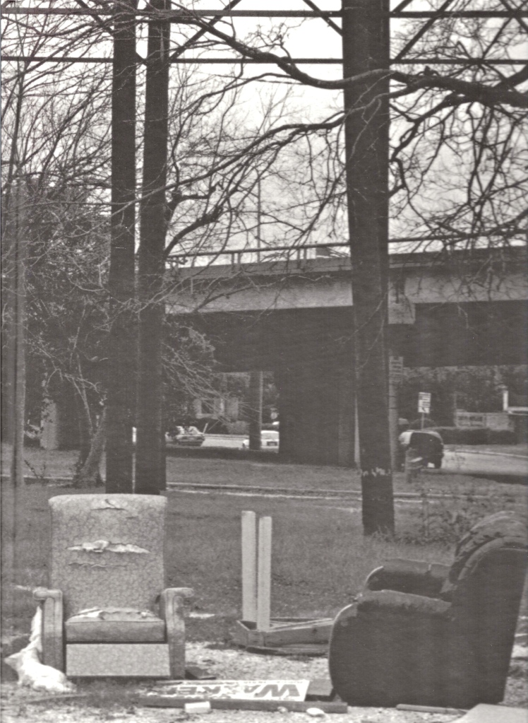 Detail of photograph by Benedict J. Fernandez of a homeless encampment in Houston, Texas between two highways.