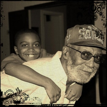 With his youngest grandchild, 2014.