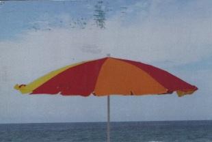 """Sitting on the Beach. Umbrellas All Around."" Photo by Christine B."